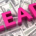 """cost per lead image showing the word """"LEAD"""" in bright pink color sitting on top of stacks of dollar bills"""